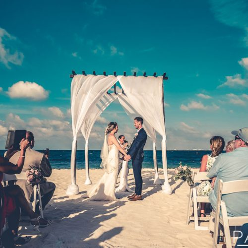 Bride and groom at beach wedding.