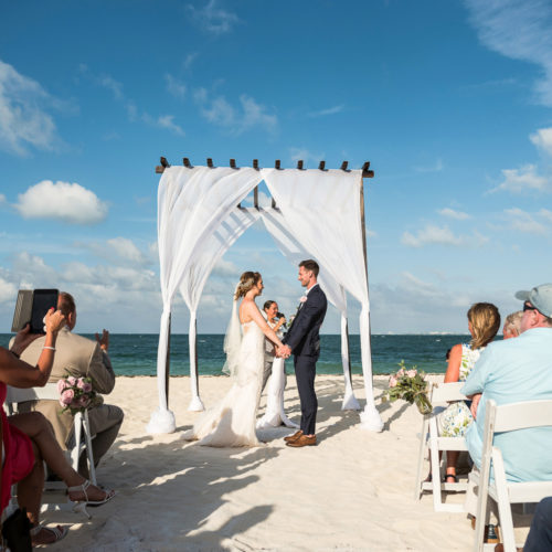 Bride and groom at beach wedding ceremony in Cancun.