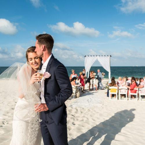Groom kissing bride after ceremony.