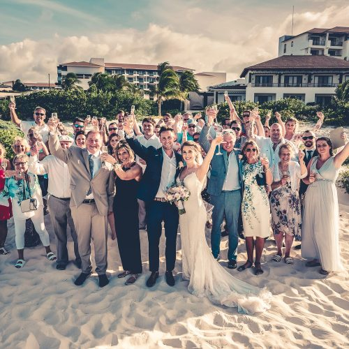 Entire wedding group on beach at Secrets Playa Mujeres, Cancun Mexico
