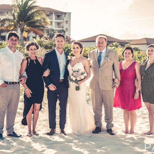 Brides family photograph after beach wedding.