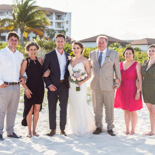 Family photograph at beach wedding.