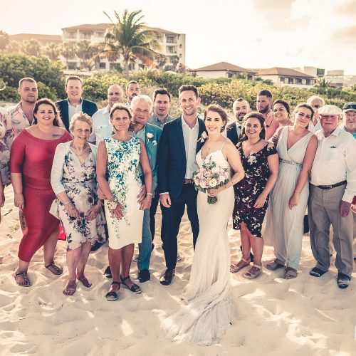 Bride and grooms family at wedding on beach at Secrets Playa Mujeres, Cancun Mexico