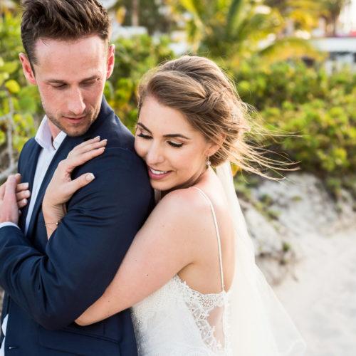 Bride hugging groom after wedding.