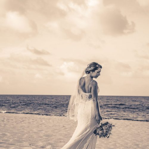 Portrait of bride on beach after wedding.
