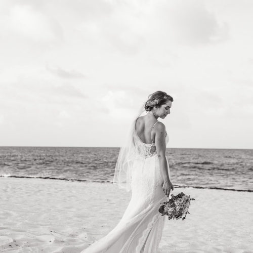 Portrait of bride on beach.