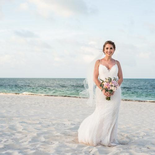 Portrait of bride on beach at Secrets Playa Mujeres resort