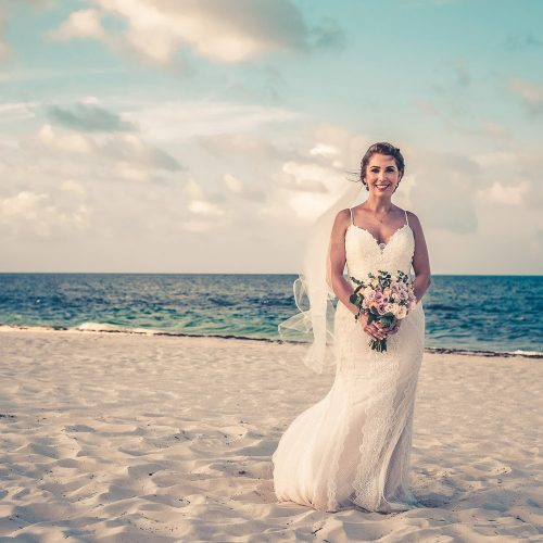 Beautiful portrait of bride on beach at Secrets Playa Mujeres, Cancun Mexico