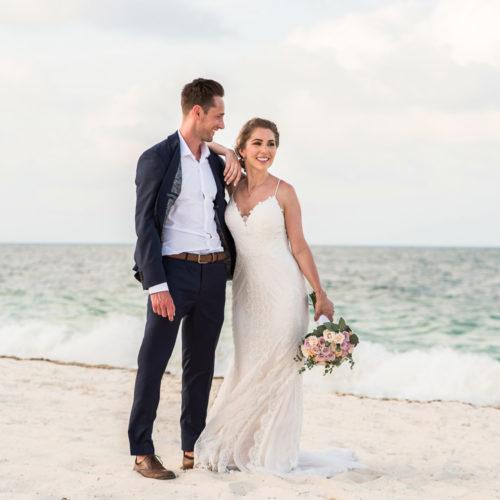Bride and groom walking on each at Secrets Playa Mujeres resort