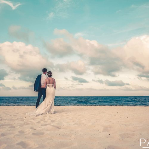 Bride and groom on beach at Cancun Wedding