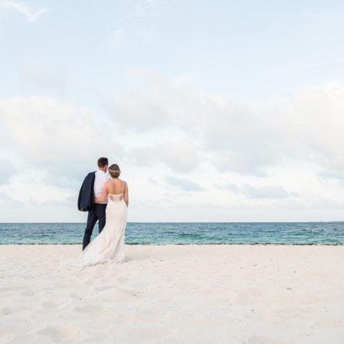 Bride and groom on beach at Secrets Playa Mujeres resort