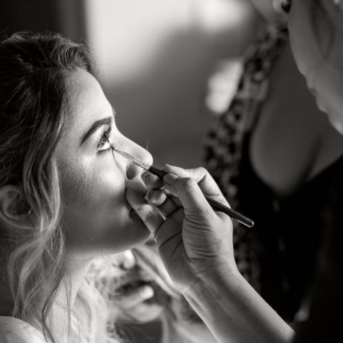 Close up of bride getting makeup put on.