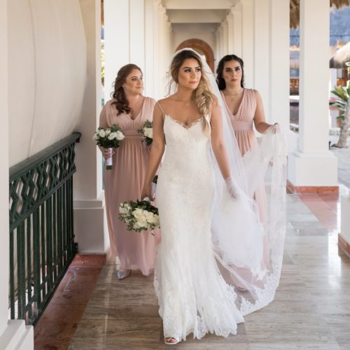 Bridesmaids walking in hall at NOW Sapphire Riviera Maya Resort