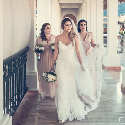 Bride and bridesmaids walking to wedding reception at NOW Sapphire Riviera Cancun resort