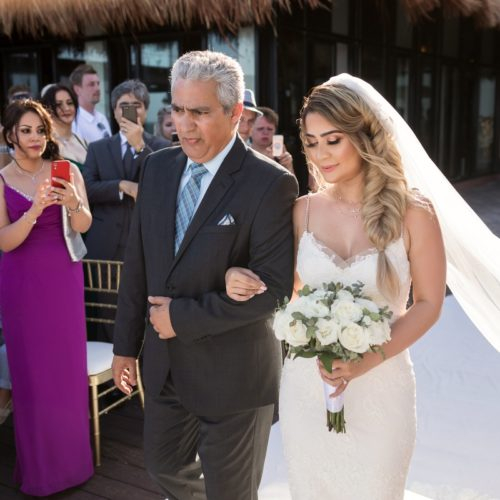 Bride walking down the aisle with father on tequila terrace NOW Sapphire Riviera Maya Resort