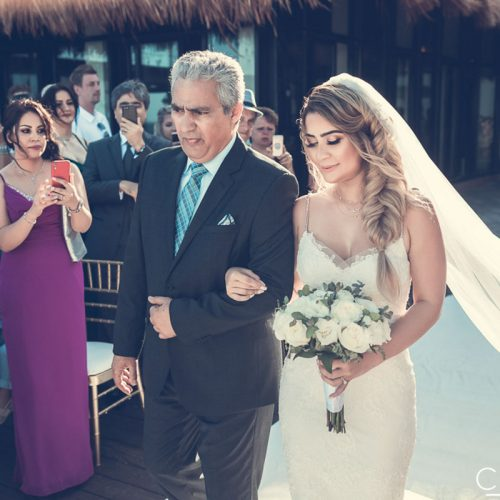 Bride and father walking down aisle at NOW Sapphire Riviera Cancun resort