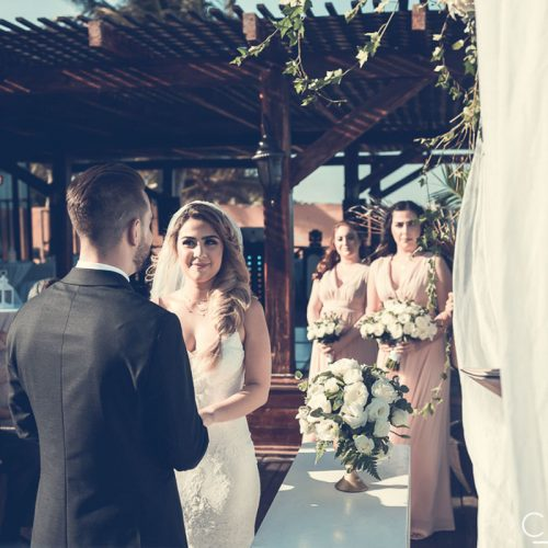 Bride and groom saying vows on tequila terrace at NOW Sapphire Riviera Cancun resort