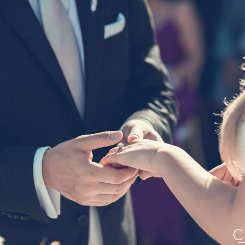 Bride and groom exchanging rings in Mexico.