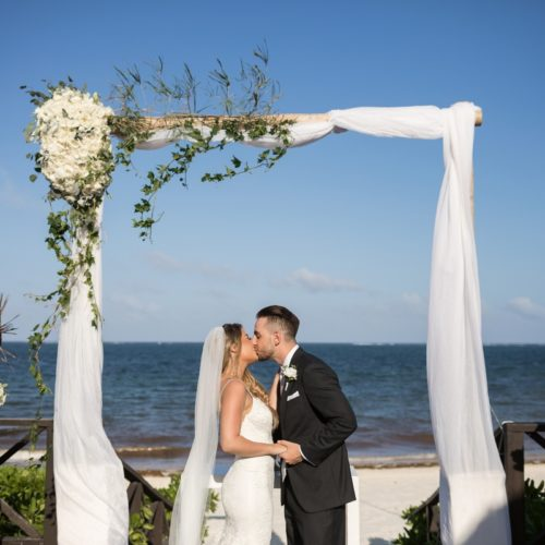 Bride and grooms first kiss at ceremony on tequila terrace at NOW Sapphire Riviera Maya Resort