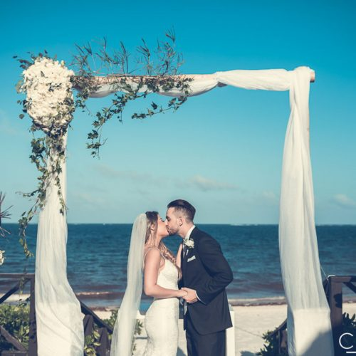 Bride and grooms first kiss on tequila terrace at NOW Sapphire Riviera Cancun resort