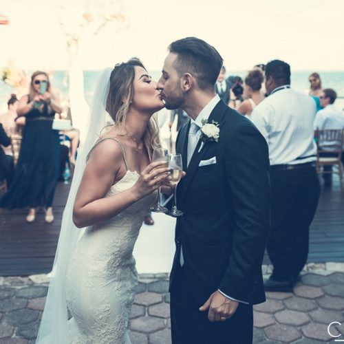 Bride and groom kissing after wedding ceremony at NOW Sapphire Riviera Cancun resort