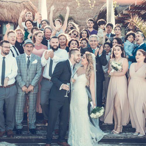 Entire wedding cheering at NOW Sapphire Riviera Cancun resort