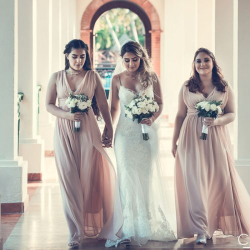 Bride and bridesmaids walking down hall at NOW Sapphire Riviera Cancun resort