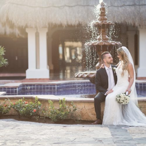 Bride and groom in front of fountain at NOW Sapphire Riviera Maya Resort