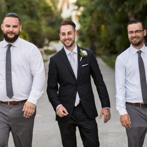 Groomsmen walking at NOW Sapphire Riviera Maya Resort
