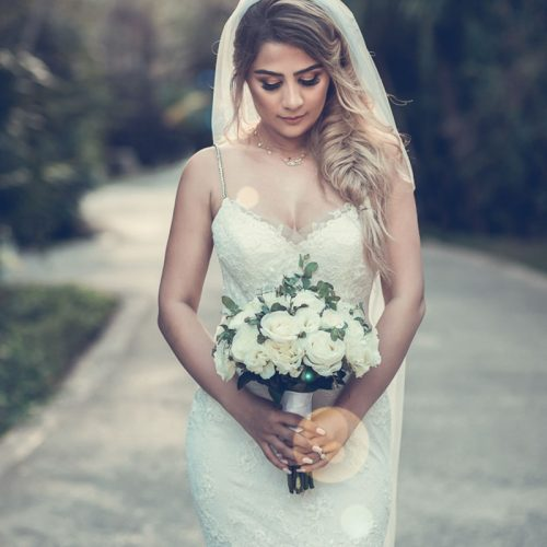 Portrait of a bride in the gardens at NOW Sapphire Riviera Cancun resort
