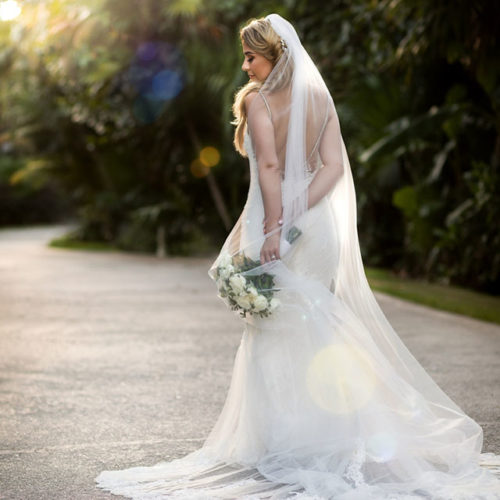 Bride in gardens at NOW Sapphire Riviera Maya Resort