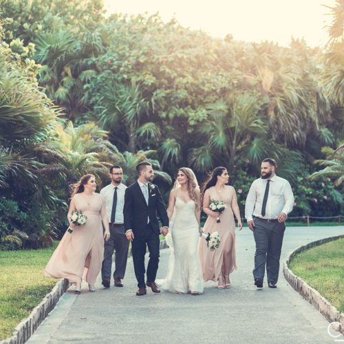Wedding party walking in garden at NOW Sapphire Riviera Cancun resort