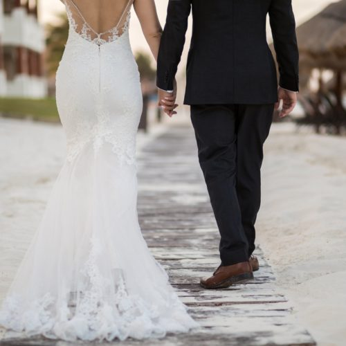 Close up of bride and groom walking away.