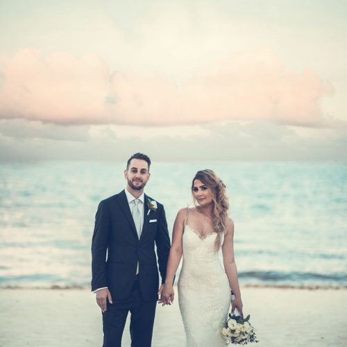 Bride and groom with ocean in background at NOW Sapphire Riviera Cancun resort