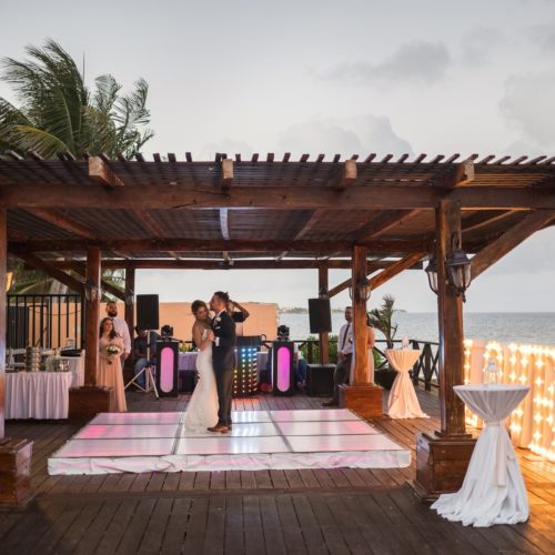 Bride and grooms first dance on tequila terrace at Bride in gardens at NOW Sapphire Riviera Maya Resort