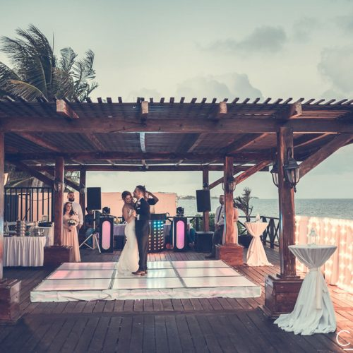 Bride and grooms first dance on tequila terrace at NOW Sapphire Riviera Cancun resort