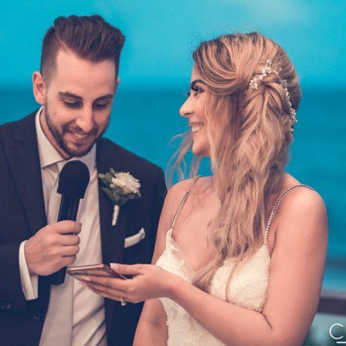Bride and groom doing speech at wedding.