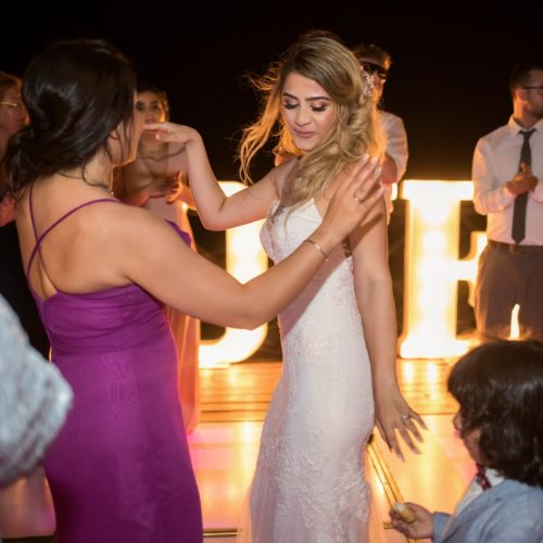 Bride dancing with guests on tequila terrace, Bride in gardens at NOW Sapphire Riviera Maya Resort
