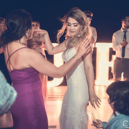 Bride dancing at wedding reception.