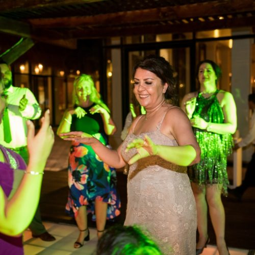 Guests dancing on tequila terrace, Bride in gardens at NOW Sapphire Riviera Maya Resort