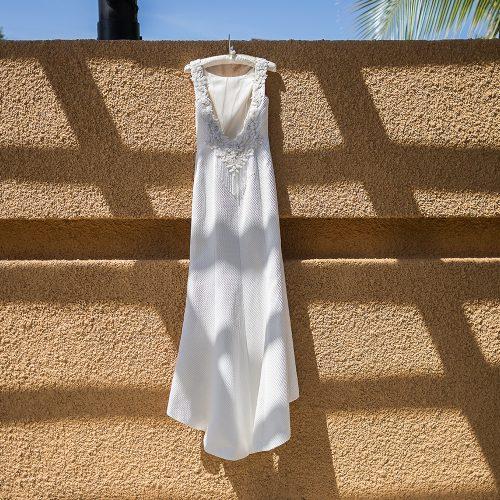Brides dress hanging on wall at Banyan Tree Mayakoba
