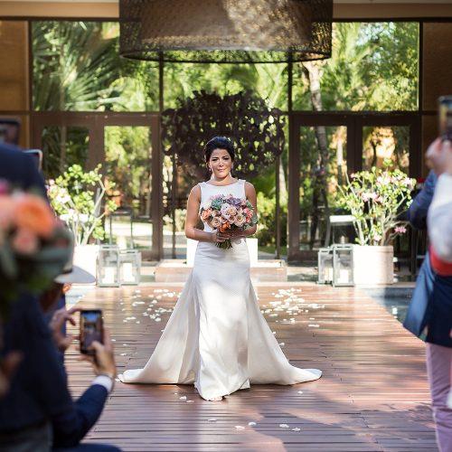 Bride walking down aisle at Banyan Tree Mayakoba