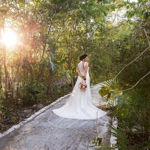 Portrait of bride from behind at Banyan Tree Mayakoba