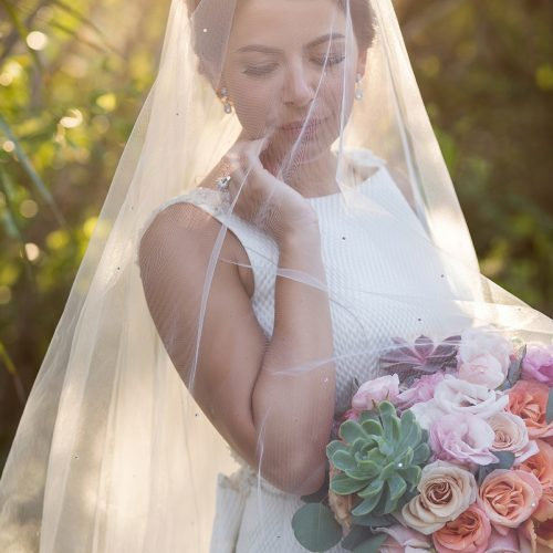 Bride under veil with beautiful light.