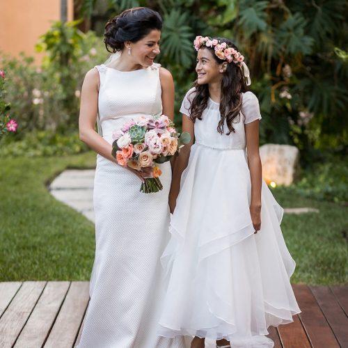 Bride with flower girl at Banyan Tree Mayakoba