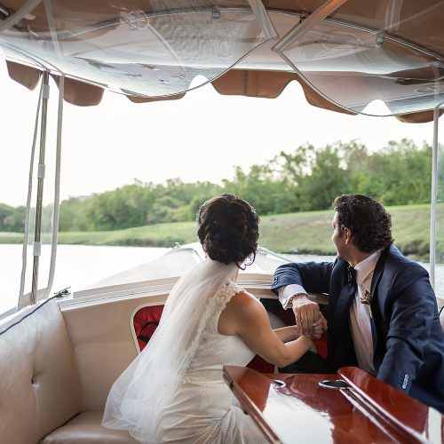 Bride and groom going to wedding ceremony by boat at Banyan Tree Mayakoba