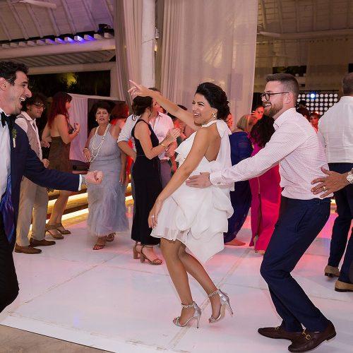 Wedding reception with people dancing at Banyan Tree Mayakoba