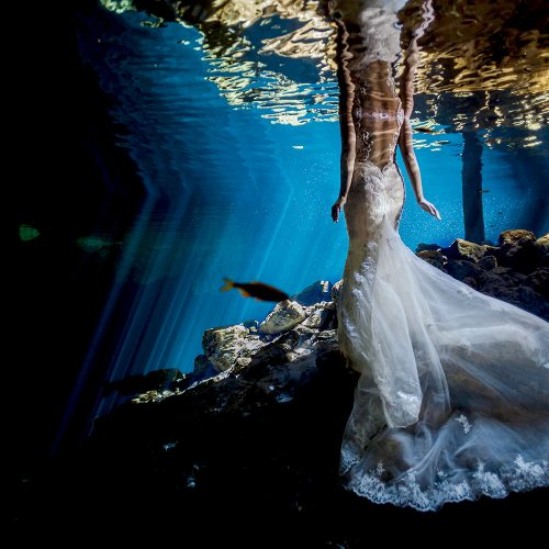 Bridal dress underwater in Mexican cenote.