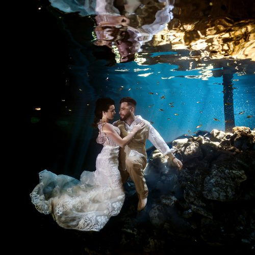 Bride and groom in cenote underwater in Mexico