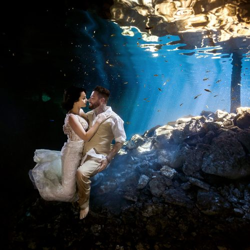 Bride and groom in underwater TTD in Mexican Cenote